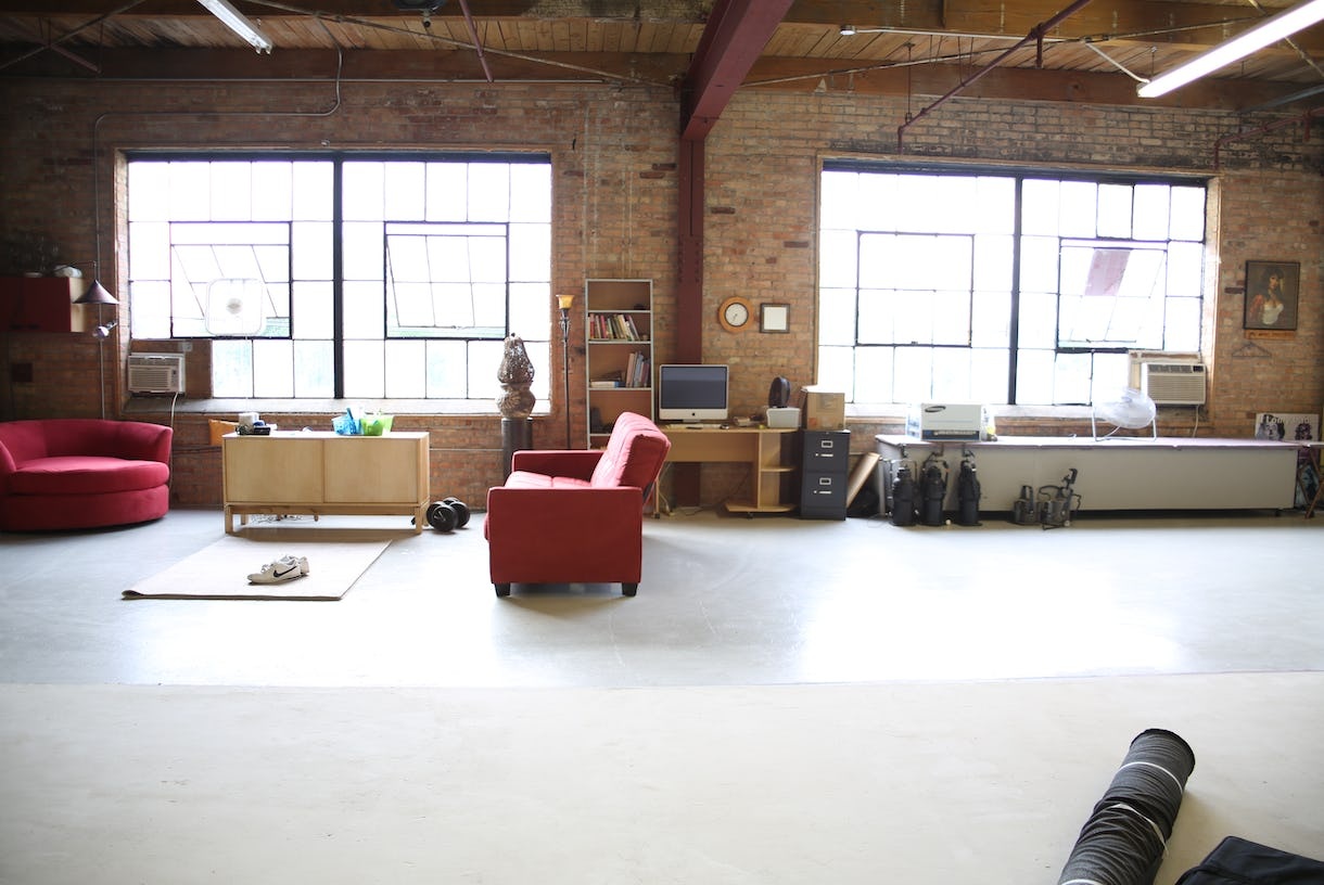 (Roc Star Studio) Bright high ceiling photography and video studio loft with exposed brick and plenty of natural sun light.