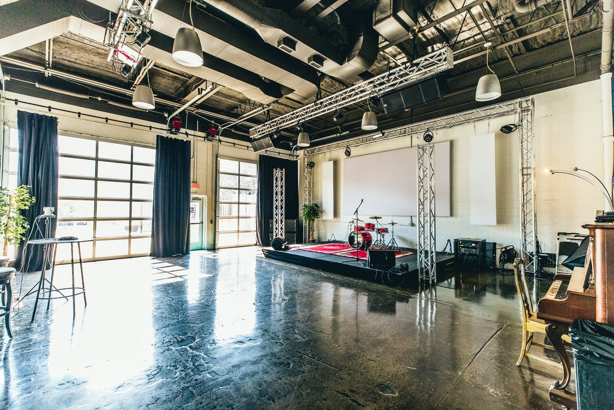 Helping Our Music Evolve (HOME) Showroom / Event room with stage
