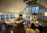 Whimsical Treehouse with Floor-to-Ceiling Windows and Indoor Rope Swings