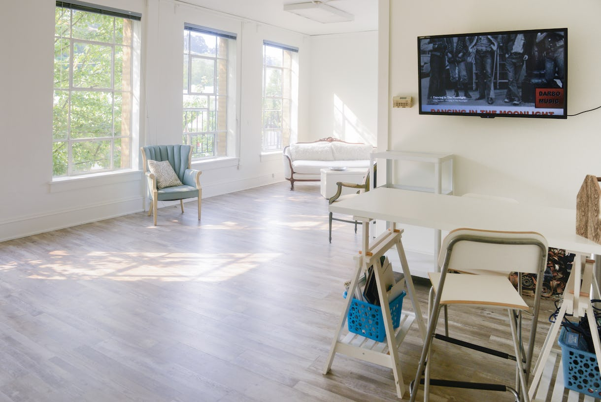 KMooney Studios - Beautifully sun-drenched studio space with white walls, silver oak-finished floors