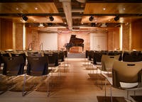 Piano centered venue with lounge